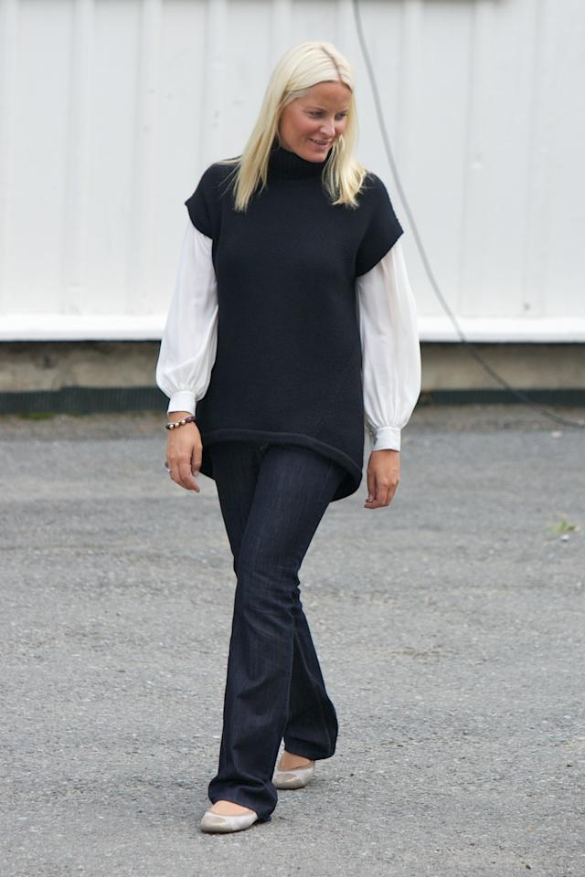 Not all princesses like skinny jeans. Mette-Marit, Crown Princess of Norway, wore a pair of dark denim with long, flared hems.