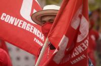 A man wearing a protective face mask amid the new coronavirus pandemic, takes part in a Panamanian Union workers' march, in the annual May Day parade in Panama City, Saturday, May 1, 2021. (AP Photo/Arnulfo Franco)