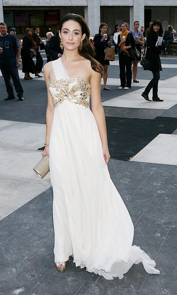 """Also in attendance ... actress Emmy Rossum, who was the belle of the ball in an ivory one-shoulder princess-like Marchesa monument, which featured an embellished bodice. Jennifer Mitchell/<a href=""""http://www.splashnewsonline.com"""" target=""""new"""">Splash News</a> - October 7, 2009"""