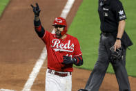 Cincinnati Reds' Nick Castellanos reacts to hitting a solo home run during the sixth inning of a baseball game against the Cleveland Indians in Cincinnati, Friday, April 16, 2021. (AP Photo/Aaron Doster)