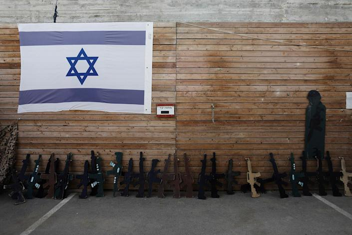 "<p>An Israeli flag and wooden cut-out rifles are seen during a two hour ""boot camp"" experience, at ""Caliber 3 Israeli Counter Terror and Security Academy "" in the Gush Etzion settlement bloc south of Jerusalem in the occupied West Bank July 13, 2017. (Photo: Nir Elias/Reuters) </p>"