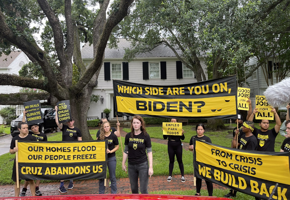 Protesters with the Sunrise Movement outside of the home of Texas Senator Ted Cruz on Monday before a number of them were arrested (Rachael Warriner)