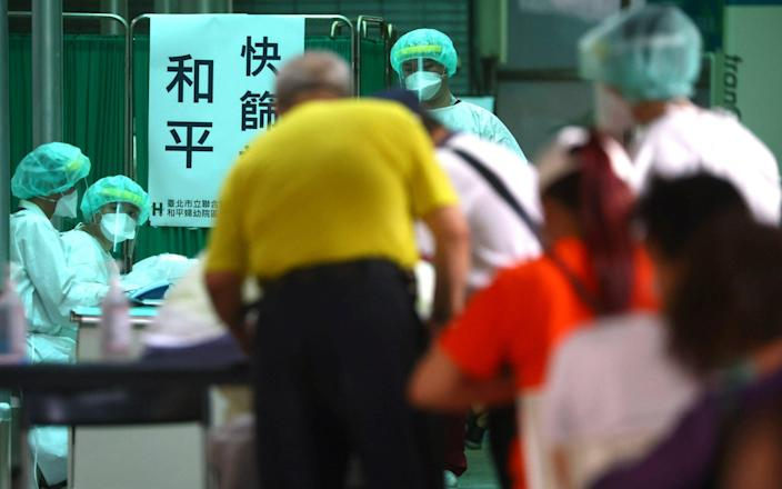 People sign up to get a rapid test following a surge of coronavirus infections in Taipei - Reuterss