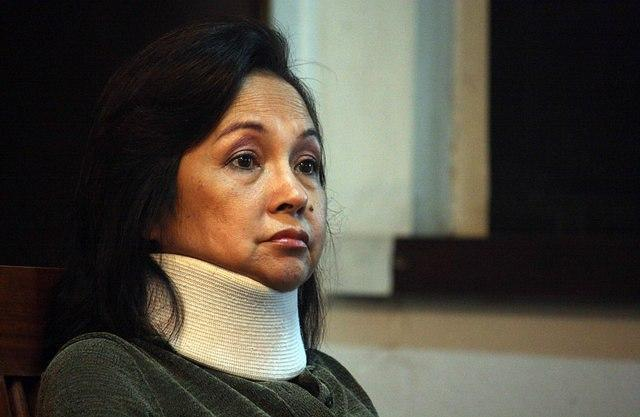 "Former president, now Pampanga Representative Gloria Macapagal-Arroyo suddenly had to be confined at the St. Luke's Medical Center in Taguig due to several ailments, just after Pasay Regional Trial Court Branch 112 Judge Jesus Mupas issued an arrest warrant for poll fraud charges. She later sought treatment abroad but was barred from leaving PH. Arroyo is still under hospital arrest at the Veterans' Memorial Medical Center.<br><br><a target=""_blank"" href=""http://ph.news.yahoo.com/comelec-oks-electoral-sabotage-raps-vs--arroyo.html"">Arroyo now under 'hospital arrest' -- authorities</a>"
