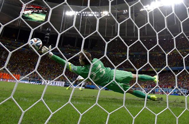 Netherlands' goalkeeper Tim Krul makes a save on a shot by Costa Rica's Michael Umana during a penalty shootout in extra time during the World Cup quarterfinal soccer match at the Arena Fonte Nova in Salvador, Brazil, Saturday, July 5, 2014. The Netherlands defeated Costa Rica 4-3 in penalties after a 0-0 tie. (AP Photo/Wong Maye-E)