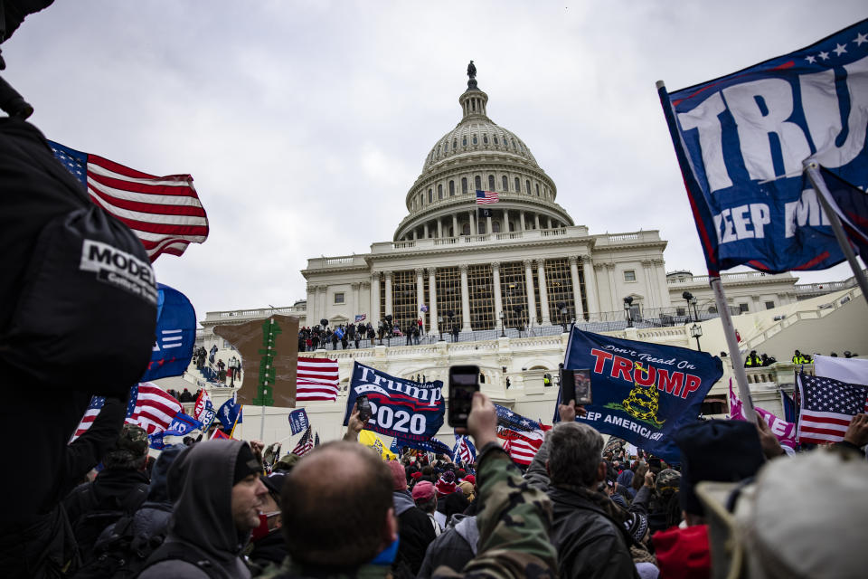 Rioters storm the U.S. Capitol following a rally with President Donald Trump on Jan. 6, 2021. (Samuel Corum/Getty Images)