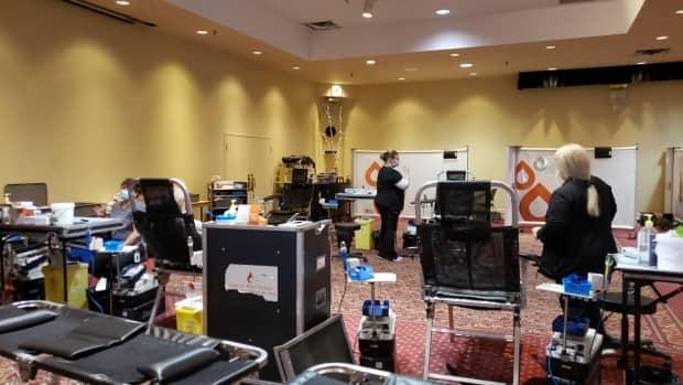 A mobile blood clinic operates Monday at the Fredericton Inn. Workers for such clinics say they want to be prioritized for receiving a COVID-19 vaccine. (Submitted by Canadian Blood Services - image credit)