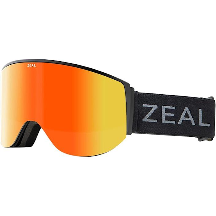 "<p><strong>Zeal</strong></p><p>amazon.com</p><p><strong>$199.00</strong></p><p><a href=""https://www.amazon.com/Zeal-Optics-Beacon-Snowboard-Goggles/dp/B08GMBMTYL?th=1&tag=syn-yahoo-20&ascsubtag=%5Bartid%7C2089.g.487%5Bsrc%7Cyahoo-us"" rel=""nofollow noopener"" target=""_blank"" data-ylk=""slk:Shop Now"" class=""link rapid-noclick-resp"">Shop Now</a></p><p>Zeal's new Beacon goggles are pretty damn innovative. They're modeled after air-traffic control towers, using what Zeal calls Observation Deck Technology, to give you a birds-eye view of the mountain below. </p><p>The frames have a lower profile, plus a 10-degree downward lens angle, which positions the lens much closer to your cheek, allowing maximum vertical peripheral vision while blocking reflections from interfering. </p><p>Each pair comes with one bright-light and one low-light lens, and there is a plentiful amount of lens types with different technologies to choose from, depending on your budget. At the low end, two non-polarized lenses will cater to the budget-minded snowboarder. In the middle, two polarized lenses protect the daily skier's eyes from the sun's UV rays. And for those with a little extra cash, two photochromic lenses that automatically adjust to variable light conditions for anyone who'd rather not switch lenses midday. Look, see, and ski better than ever before. <br></p><p><strong>More:</strong> <a href=""https://www.bestproducts.com/fitness/a14527722/reviews-best-skis-for-men-women/"" rel=""nofollow noopener"" target=""_blank"" data-ylk=""slk:Rage the Slopes With These Top-Rated Men's Skis"" class=""link rapid-noclick-resp"">Rage the Slopes With These Top-Rated Men's Skis</a></p>"
