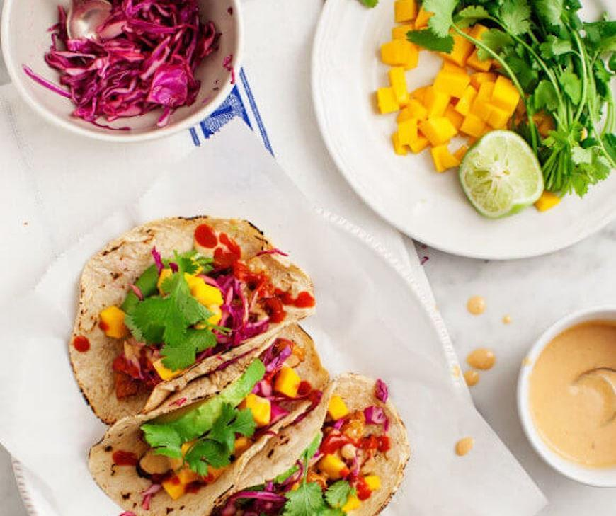 """<p>These colorful tacos have a sweet and savory twist.</p> <p>Get the recipe <a href=""""https://www.loveandlemons.com/mango-peanut-tempeh-tacos/"""" rel=""""nofollow noopener"""" target=""""_blank"""" data-ylk=""""slk:here"""" class=""""link rapid-noclick-resp"""">here</a>.</p>"""