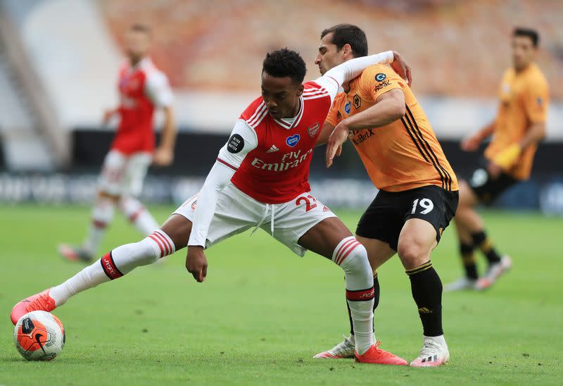 Arsenal halt Wolves charge with 2-0 victory