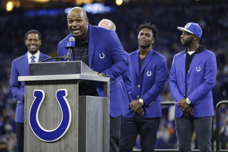 Former Indianapolis Colts defensive end Dwight Freeney speaks during his Ring of Honor induction ceremony during half time of an NFL football game against the Miami Dolphins in Indianapolis, Sunday, Nov. 10, 2019. (AP Photo/Darron Cummings)