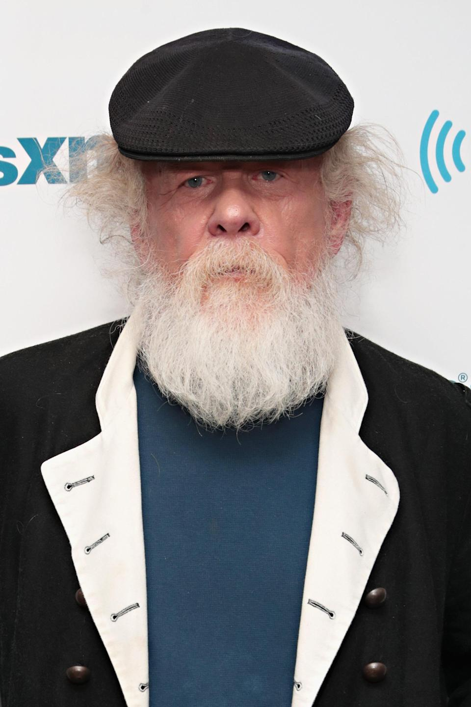 """Former """"Sexiest Man Alive"""" Nick Nolte, seen here at the SiriusXM Studios on March 12, 2018, is looking like Santa Claus these days. (Photo: Cindy Ord/Getty Images)"""