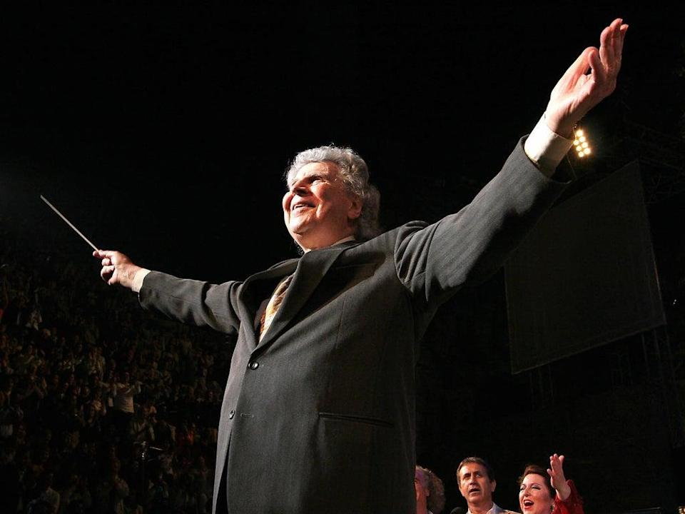Theodorakis directing his orchestra during a gala concert at the Herodes Atticus Ancient Theatre in Athens (AFP/Getty)