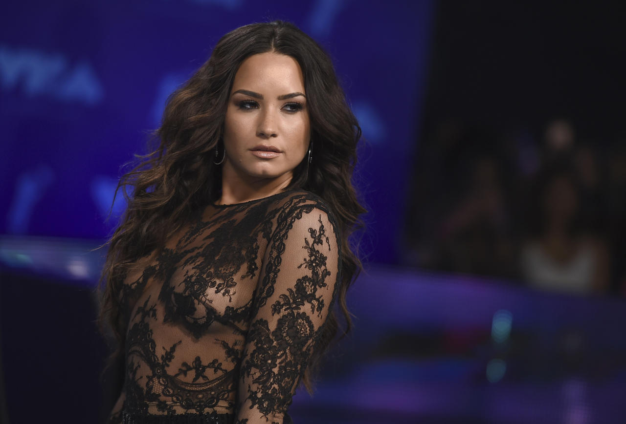 FILE - In this Aug. 27, 2017 file photo, Demi Lovato arrives at the MTV Video Music Awards at The Forum in Inglewood, Calif. Lovato was named a Global Citizen mental health ambassador Saturday at the organization's music festival in New York City's Central Park. (Photo by Jordan Strauss/Invision/AP, File)