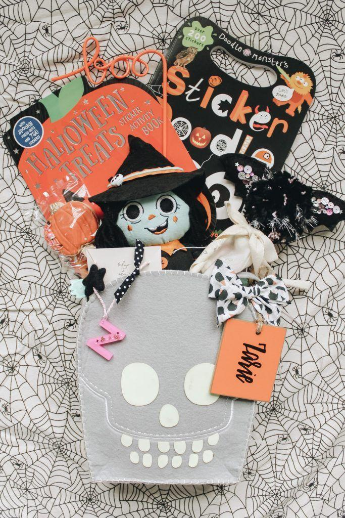 """<p>In addition to a Good Witch stuffy from Target, this basket also has activities that will last them until it's time to go trick-or-treating, like a <a href=""""https://www.amazon.com/dp/1789477026?tag=syn-yahoo-20&ascsubtag=%5Bartid%7C10055.g.34288815%5Bsrc%7Cyahoo-us"""" rel=""""nofollow noopener"""" target=""""_blank"""" data-ylk=""""slk:Halloween sticker activity book"""" class=""""link rapid-noclick-resp"""">Halloween sticker activity book</a>. </p><p><a href=""""https://occasionsbyshakira.com/2020/09/15/boo-baskets-2020/"""" rel=""""nofollow noopener"""" target=""""_blank"""" data-ylk=""""slk:See more at Occasions By Shakira »"""" class=""""link rapid-noclick-resp""""><em>See more at Occasions By Shakira »</em></a></p>"""