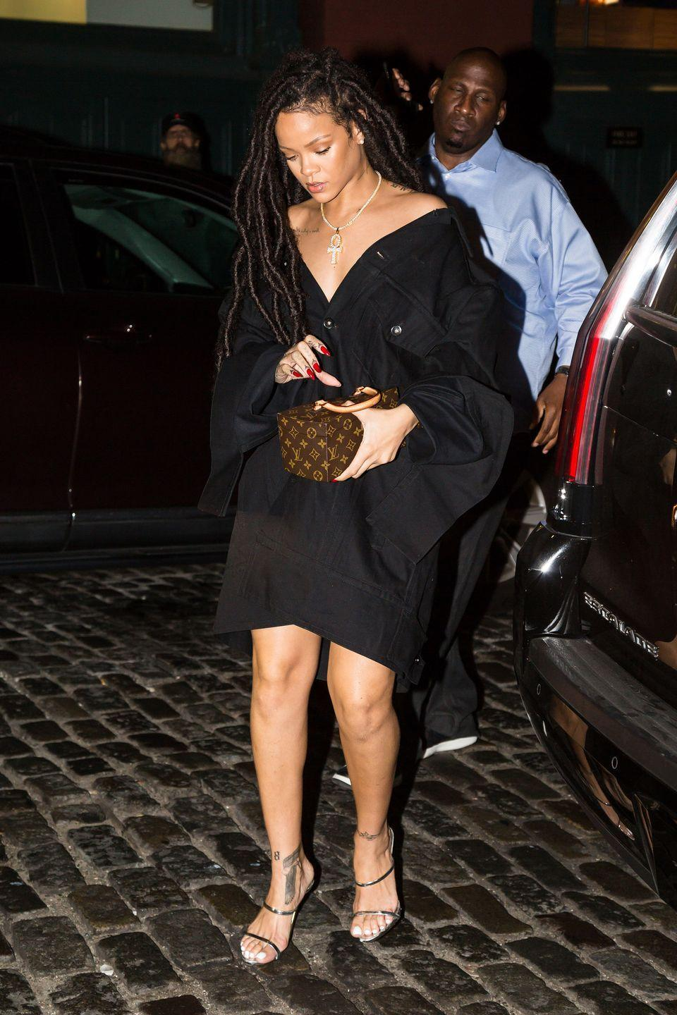 <p>In a black off-the-shoulder oversized shirtdress, silver heels and a Louis Vuitton box bag for a night out in NYC.</p>