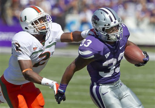 Miami defensive back Deon Bush (2) catches up with Kansas State running back John Hubert (33) during the first half of an NCAA football game in Manhattan, Kan., Saturday, Sept. 8, 2012. (AP Photo/Orlin Wagner)