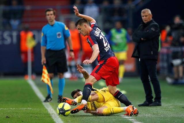 Soccer Football - Ligue 1 - Caen vs Paris St Germain - Stade Michel d'Ornano, Caen, France - May 19, 2018 Paris Saint-Germain's Yuri Berchiche in action with Caen's Frederic Guilbert REUTERS/Pascal Rossignol