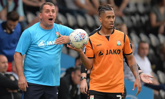 Martin Allen (left) and Barnet defender Richard Brindley know they must beat Chesterfield on Saturday and hope Morecambe lose at Coventry.