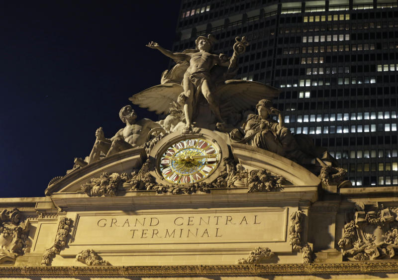 The mythological figures Hercules, Mercury, and Minerva adorn the main facade of Grand Central Terminal, part of a sculptural group created by Jules Alexis, atop the terminal in New York, Tuesday, Jan. 8, 2013. Constructed in 1913 by the Vanderbilt family, railroad barons and wealthy industrialists, the terminal is the country's most famous train station and one of the finest examples of Beaux Arts architecture in America. The building turns 100 on Feb. 1st. (AP Photo/Kathy Willens)
