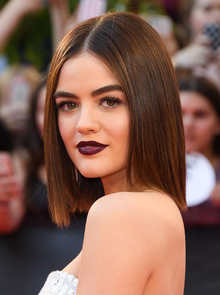 "<p>The ""Pretty Little Liars"" star proved that dark lips don't have to be reserved for fall and winter. She made this deep berry hue work by keeping the rest of her look extremely neutral – pin-straight hair, a sweep of dramatic mascara and perfect brows. <i>(Photo by George Pimentel/WireImage)</i><br /></p>"
