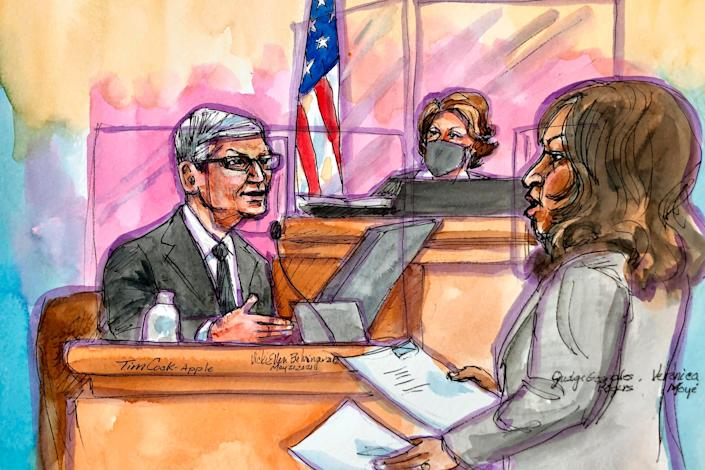 This artist rendering shows Apple CEO Tim Cook on the witness stand being questioned by Apple's attorney Veronica Moyéduring a trial in San Ramon, Calif., on Friday, May 21, 2021.