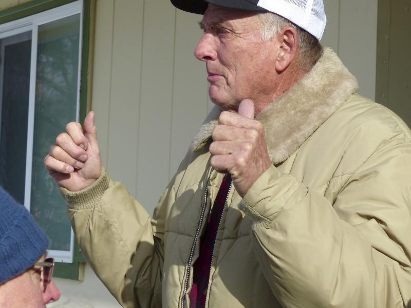 FILE - In this Jan. 2, 2016, file photo, rancher Dwight Hammond Jr. greets protesters outside his home in Burns, Ore. President Donald Trump has pardoned Dwight and Steven Hammond, two ranchers whose case sparked the armed occupation of a national wildlife refuge in Oregon. The Hammonds were convicted in 2012 of intentionally and maliciously setting fires on public lands. (Les Zaitz/The Oregonian via AP, File)