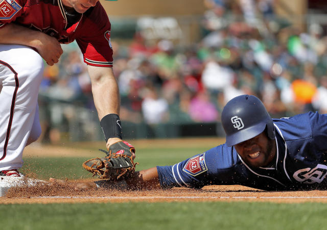 San Diego Padres' Manuel Margot is picked off first by Arizona Diamondbacks' Paul Goldschmidt during the second inning of a spring training baseball game Saturday, March 17, 2018, in Scottsdale, Ariz. (AP Photo/Matt York)