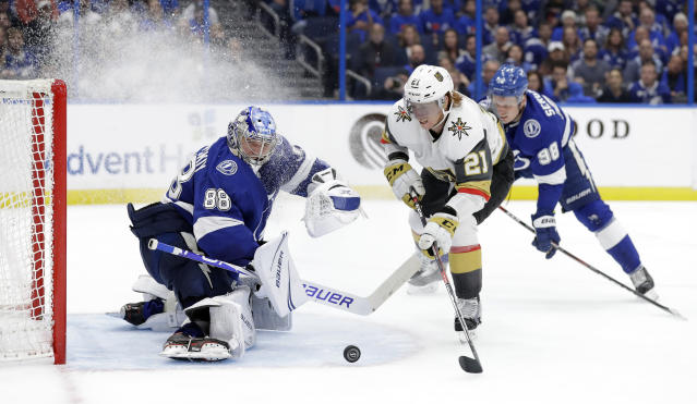 Tampa Bay Lightning goaltender Andrei Vasilevskiy (88) stops a shot by Vegas Golden Knights center Cody Eakin (21) during the third period of an NHL hockey game Tuesday, Feb. 5, 2019, in Tampa, Fla. (AP Photo/Chris O'Meara)