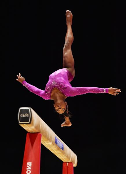 Simone Biles scored 15.358 to take the balance beam title by a 1.025 margin on Sanne Wevers (AFP Photo/Ben Stansall, Ben Stansall)