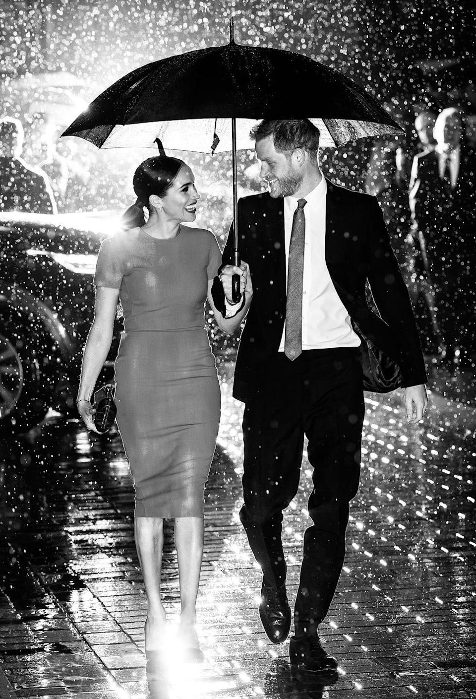 "<p>This photo, taken at the start of the Sussexes' so-called farewell tour by Samir Hussein, <a href=""https://www.townandcountrymag.com/society/tradition/a31290415/meghan-markle-prince-harry-umbrella-photo-endeavour-fund-awards-interview/"" rel=""nofollow noopener"" target=""_blank"" data-ylk=""slk:is being called historic for how it captured the moment."" class=""link rapid-noclick-resp"">is being called historic for how it captured the moment.</a></p>"