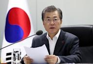South Korean President Moon Jae-in presides over the national security council at the Presidential Blue House in Seoul, South Korea, November 29, 2017. The Presidential Blue House/Yonhap via REUTERS/Files
