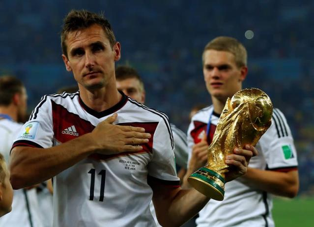FILE PHOTO: Germany's Klose holds the World Cup trophy after the 2014 World Cup final against Argentina at the Maracana stadium in Rio de Janeiro