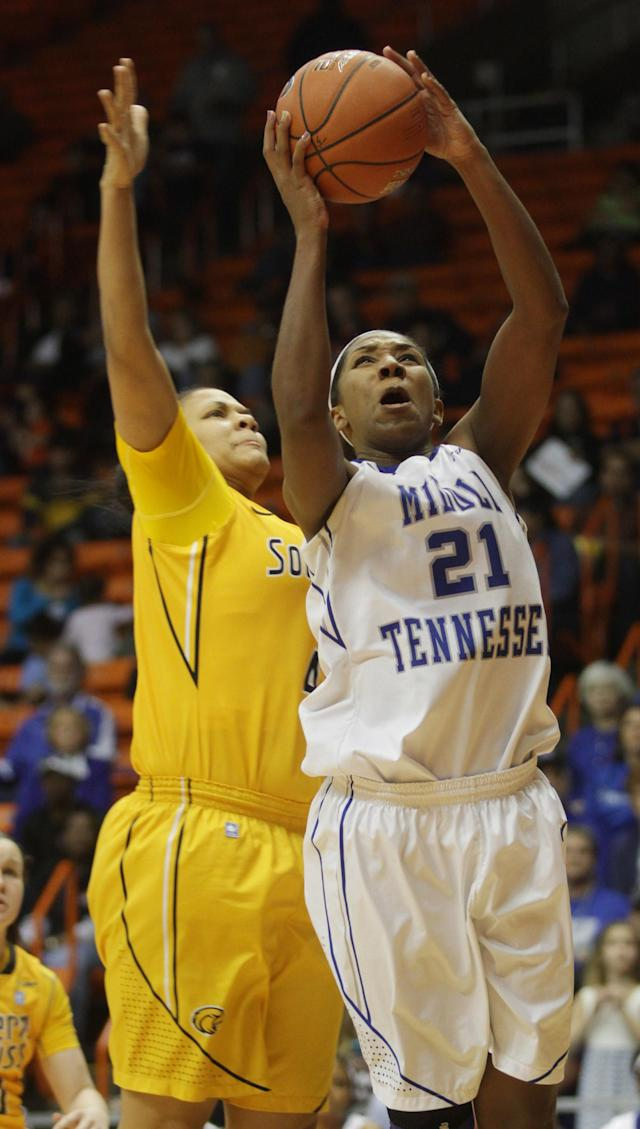 Ebony Rowe scores after eluding Southern Miss' Tamara Jones during the second half of their NCAA Conference USA tournament championship basketball game Saturday, March 15, 2014 in El Paso, Texas. (AP Photo/Victor Calzada)