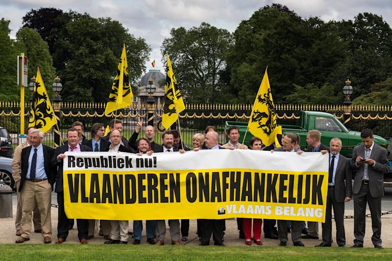 Nationalists of the Dutch speaking political party Vlaams Belang protest in front of the Belgian Royal Palace in Laeken, near Brussels, Wednesday, July 3, 2013. Belgian King Albert has unexpectedly announced that he will step down in favor of his son, Crown Prince Philippe. on July 21, 2013. Banner reads: 'Republic now, Flanders independent'. (AP Photo)