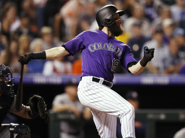 Colorado Rockies' Charlie Blackmon watches his walk-off solo home run off Houston Astros relief pitcher Collin McHugh in a baseball game Wednesday, July 25, 2018, in Denver. The Rockies won 3-2. (AP Photo/David Zalubowski)