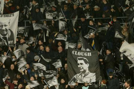FILE PHOTO: Britain Football Soccer - Derby County v Leicester City - FA Cup Fourth Round - Pride Park - 27/1/17 Derby fans hold up a flag of former manager Brian Clough Action Images via Reuters / Andrew Boyers Livepic