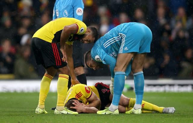 Watford's Craig Dawson lies in pain with a head injury during this season's Premier League match against Burnley at Vicarage Road Nigel French/PA)