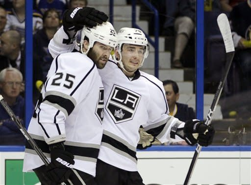 Los Angeles Kings' Slava Voynov, of Russia, is congratulated by Dustin Penner, left, after scoring against the St. Louis Blues during the first period of Game 1 in a second-round NHL Stanley Cup hockey playoff series, Saturday, April 28, 2012, in St. Louis. (AP Photo/Jeff Roberson)