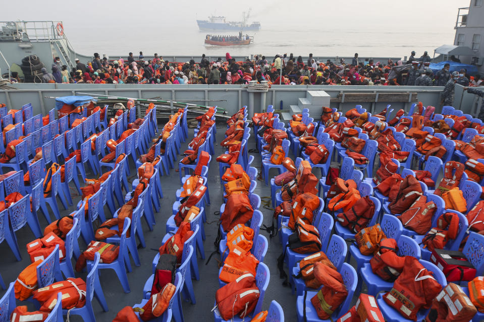 Life vests are placed on chairs as Rohingya refugees headed to the Bhasan Char island arrive to board navy vessels from the south eastern port city of Chattogram, Bangladesh, Monday, Feb.15,2021. Authorities sent a fourth group of Rohingya refugees to the newly developed island in the Bay of Bengal on Monday amid calls by human rights groups for a halt to the process. (AP Photo)