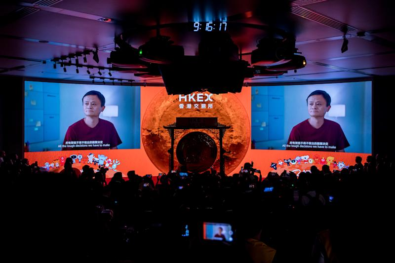 Jack Ma, former chairman of Alibaba Group Holding Ltd., is displayed on screens during the company's listing ceremony at the Hong Kong Stock Exchange in Hong Kong, China, on Tuesday, Nov. 26, 2019. Photo: Paul Yeung/Bloomberg
