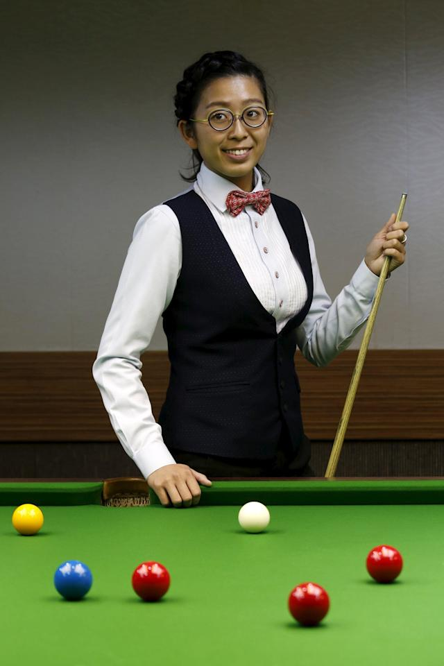 Ng Ong-yee, 25, 2015 Ladies World Snooker Championship winner, poses during an interview in Hong Kong, China January 27, 2016. A decade after taking up the sport because she liked her father's outfit, Hong Kong's Ng On Yee finds herself on the brink of snooker history as she embarks on a mission to reach the main draw of the men's world championships. Picture taken January 27, 2016. REUTERS/Bobby Yip TPX IMAGES OF THE DAY