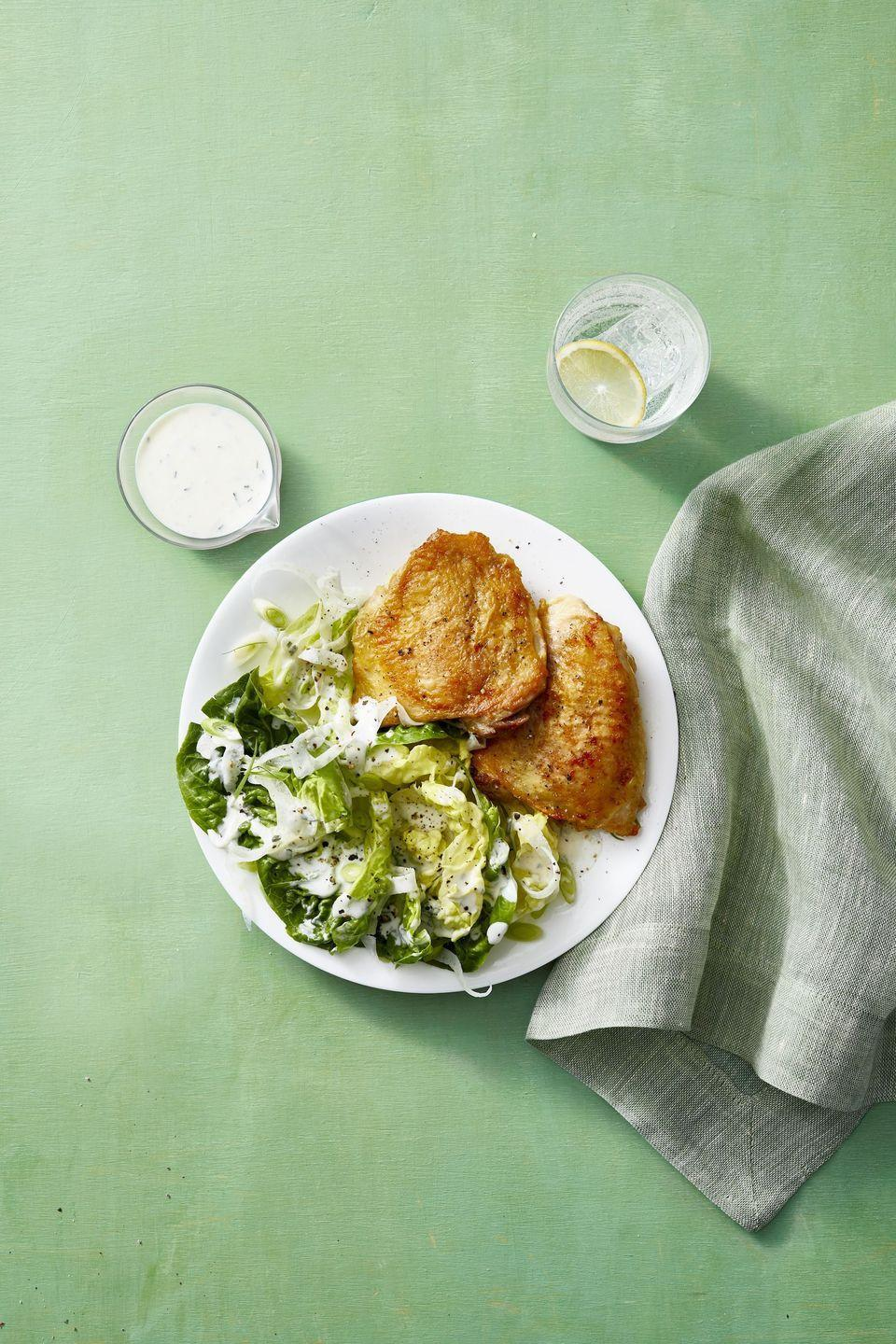 "<p>Chicken thighs are cheap, delicious, and most of all, so easy and versatile to make. This version sings thanks to a creamy salad with a riff on ranch dressing.</p><p><a href=""https://www.womansday.com/food-recipes/a31979640/crispy-chicken-thighs-with-buttermilk-fennel-salad-recipe/"" rel=""nofollow noopener"" target=""_blank"" data-ylk=""slk:Get the recipe from Woman's Day »"" class=""link rapid-noclick-resp""><em>Get the recipe from Woman's Day »</em> </a></p>"