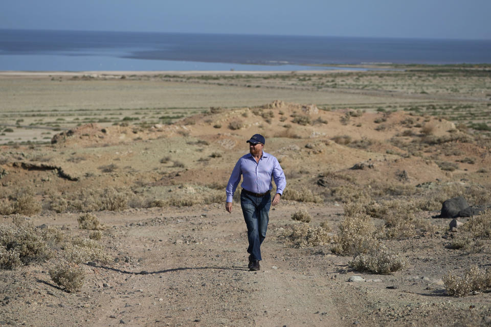 Rod Colwell, CEO of Controlled Thermal Resources, walks on the company's property, which will be mined for lithium, in Niland, Calif., near the shores of the Salton Sea, Thursday, July 15, 2021. Demand for electric vehicles has shifted investments into high gear to extract lithium from geothermal wastewater around the shrinking body of water. The ultralight metal is critical to rechargeable batteries. (AP Photo/Marcio Jose Sanchez)