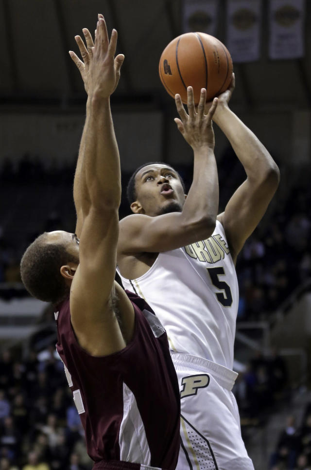Purdue forward Basil Smotherman, right, shoots over Maryland-Eastern Shore guard Ishaq Pitt in the first half of an NCAA college basketball game in West Lafayette, Ind., Tuesday, Dec. 17, 2013. (AP Photo/Michael Conroy)