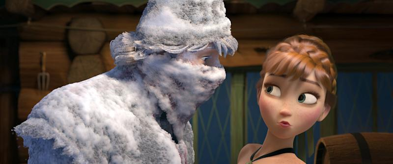"This image released by Disney shows Kristoff, voiced by Jonathan Groff, left, and Anna, voiced by Kristen Bell, in a scene from the animated feature film, ""Frozen."" (AP Photo/Disney)"