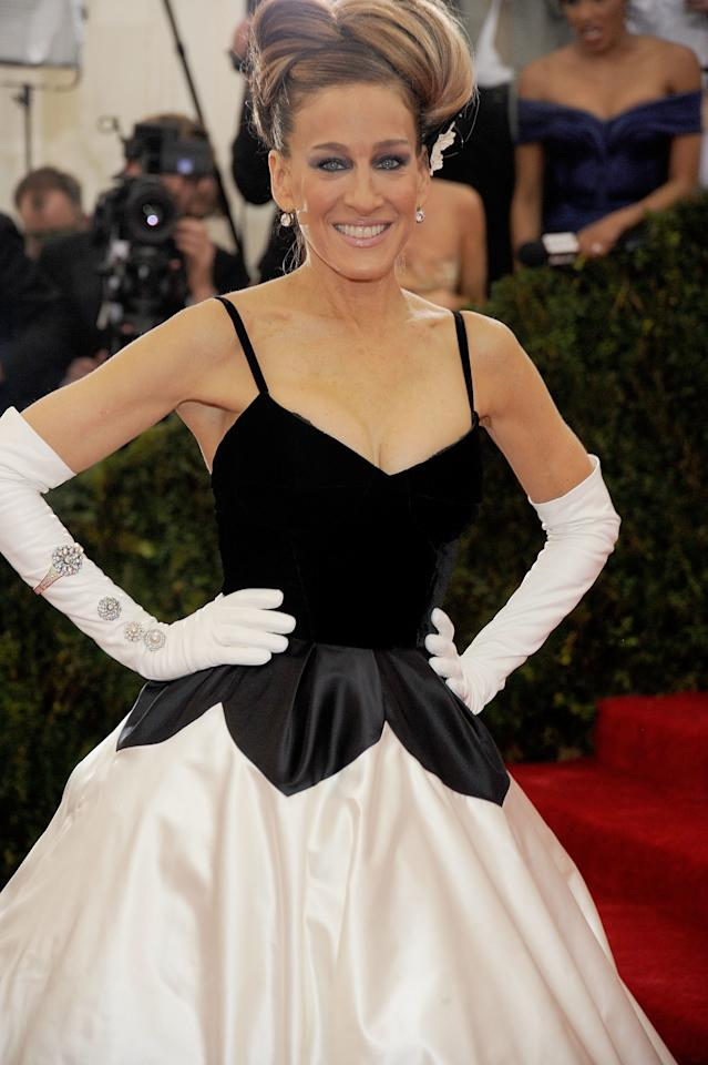 "<p>Sarah Jessica Parker doubled down on a full Charles James look with a voluminous, ladylike bun that echoed his frocks.</p><p>Sarah Jessica Parker at the 2014 Met Gala ""Charles James: Beyond Fashion."" </p>"