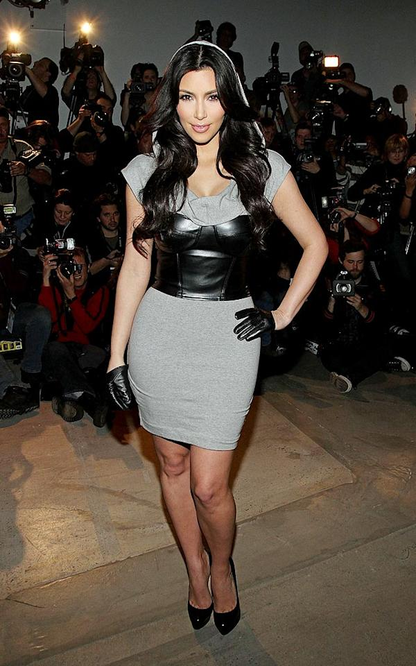 """Kim Kardashian modeled one of her own designs as she debuted the Kardashians by Bebe collection at Fashion Week. Her inspiration? Kim told <i>People</i>, """"We wanted to show us being voluptuous, sexy women. We took a little from each of our personal styles."""" And as for her design partners? Kim joked with reporters -- """"I wish my sisters were here. They ditched me on this one!"""" Jerritt Clark/<a href=""""http://www.wireimage.com"""" target=""""new"""">WireImage.com</a> - February 16, 2010"""