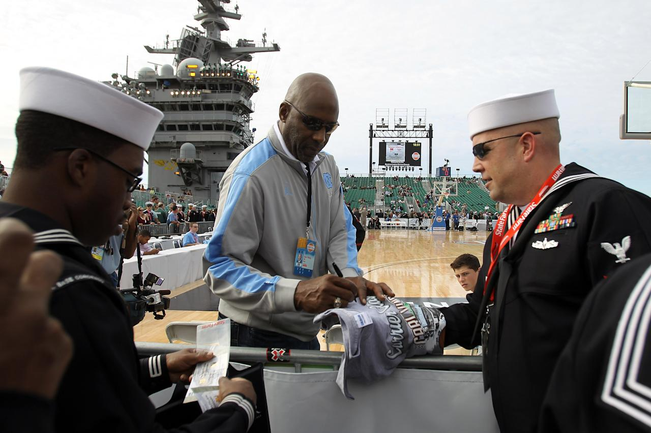 SAN DIEGO, CA - NOVEMBER 11:  Basketball hall-of-famer and North Carolina Tar Heels alum James Worthy signs autographs and talks with members of the media before the Tar Heels take on the Michigan State Spartans in the NCAA men's college basketball Carrier Classic aboard the flight deck of the USS Carl Vinson on November 11, 2011 in San Diego, California.  (Photo by Ezra Shaw/Getty Images)