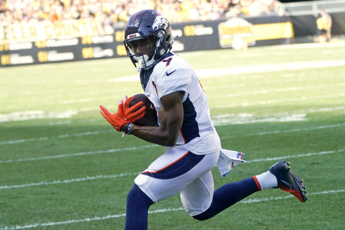 Denver Broncos wide receiver Kendall Hinton (9) catches a pass from quarterback Teddy Bridgewater for a touchdown during the second half of an NFL football game against the Pittsburgh Steelers in Pittsburgh, Sunday, Oct. 10, 2021. (AP Photo/Keith Srakocic)